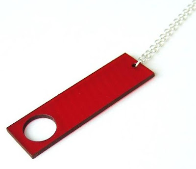 Aroha Silhouettes jewellery made from recycled vinyl records - vibrant red Peephole necklace