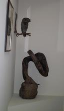 Wooden sculpture under Stuffed owl