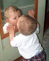 Baby kissing mirror image