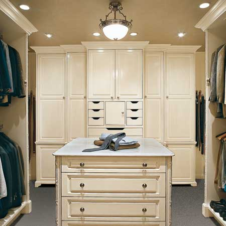 Create a cabinetry island in the center of your closet for additional