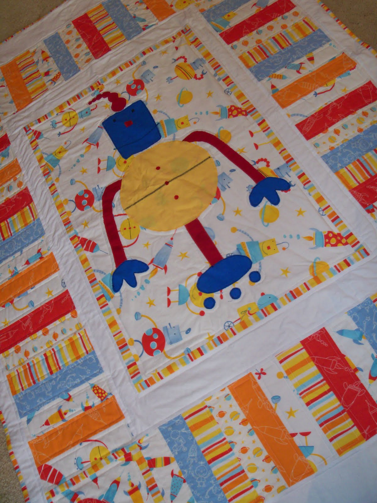 Early bird crafts cole 39 s robot quilt for Robot quilt fabric