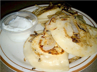 Potato and Cheese Pierogi with Onions and Sour Cream