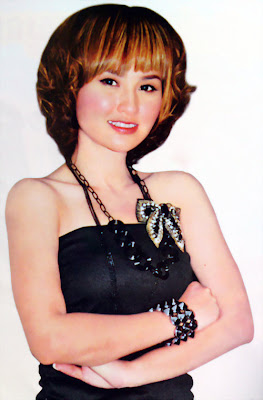 sokun nisa khmer singer with new hair style