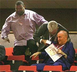 An octogenarian heckler is removed from Conference