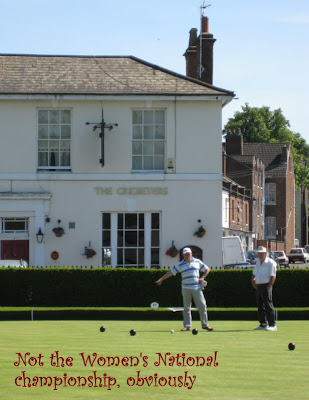 Bowling in front of the Cricketers pub