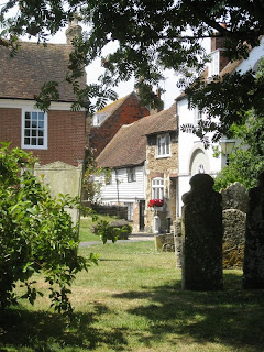View of tombstones and houses from Rye church