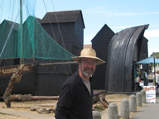 Mr A with Hastings boats and beach huts