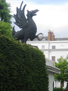Black Griffin with open mouth on a pillar in Leamington Spa