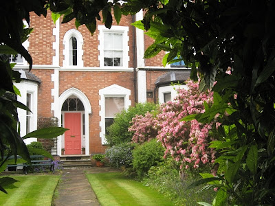 View of front door and lawn through arch of leaves, Leamington Spa