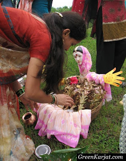 woman worshipping goddess gauri