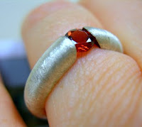 garnet tenstion set ring sterling silver