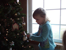 Bre helping to decorate the tree