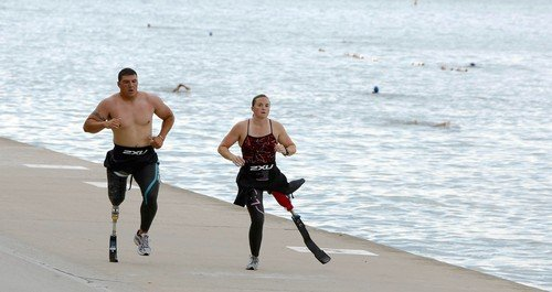 WWP's Chad Watson and Melissa Stockwell training for the 2009 Accenture ParaTriathlon Challenge in