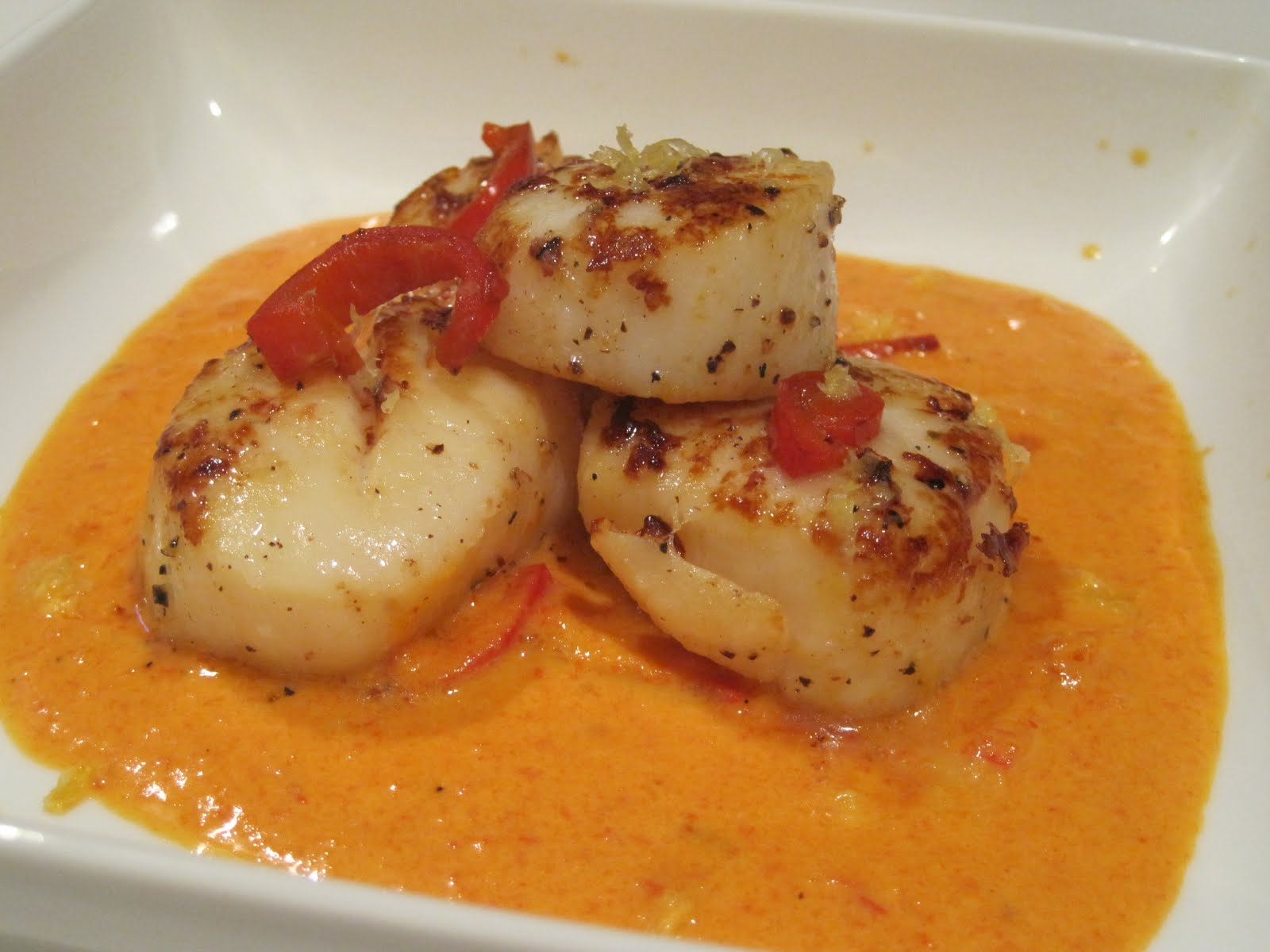 ... these scallops combines red bell peppers with hot peppers to get the