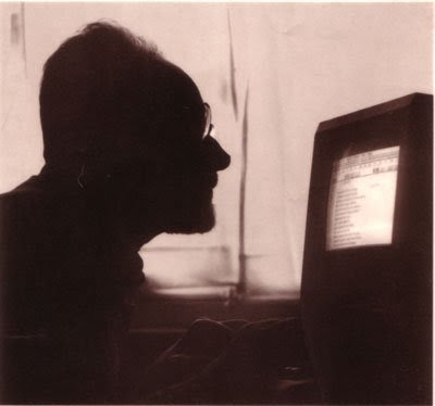 Primo Levi writing at his computer