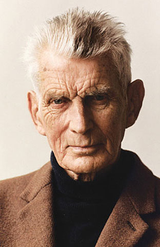 Colour Photograph of Samuel Beckett in blazer and turtleneck
