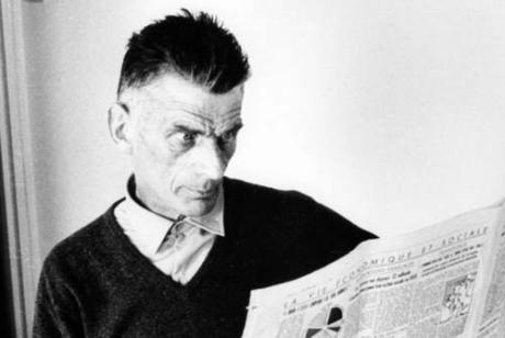 Samuel Beckett reading a newspaper. Photograph by Jerry Bauer