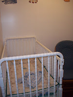Rocking chair moves next to crib