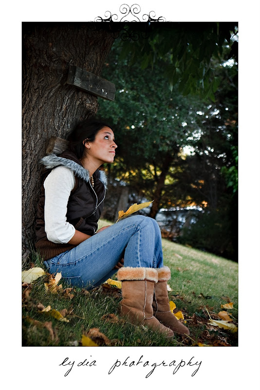 Birde sitting against the tree looking up at lifestyle engagement portraits in Grass Valley, California