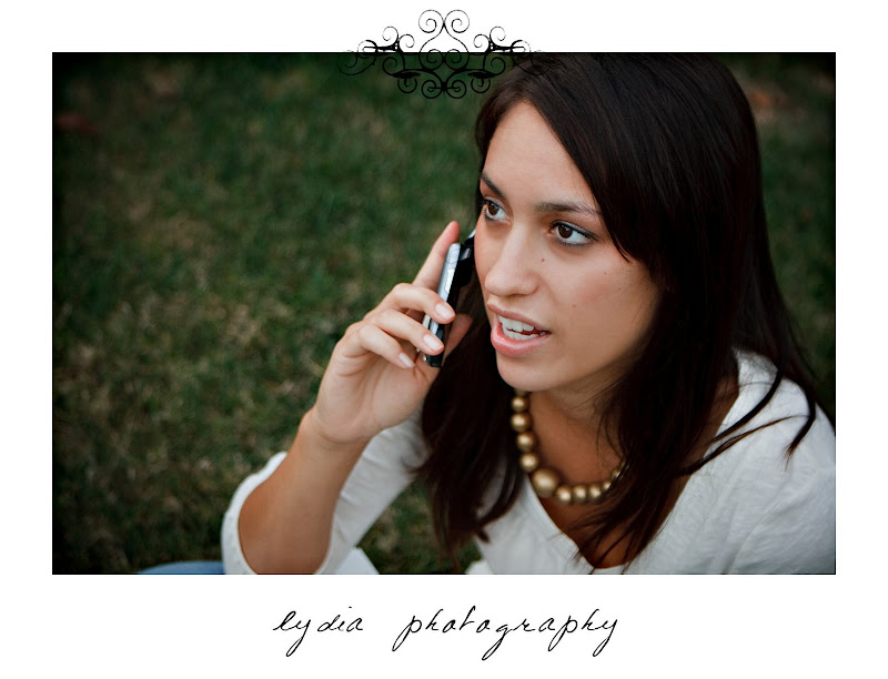 Bride on the phone at lifestyle engagement portraits in Grass Valley, California