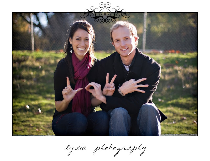 Bride and groom's hands spll love at lifestyle park engagement portraits in Auburn, California
