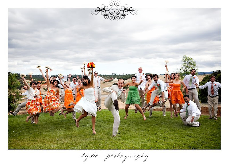 Bride and groom and wedding party jumping at modern, citrus, backyard wedding at Pine Ranch in California