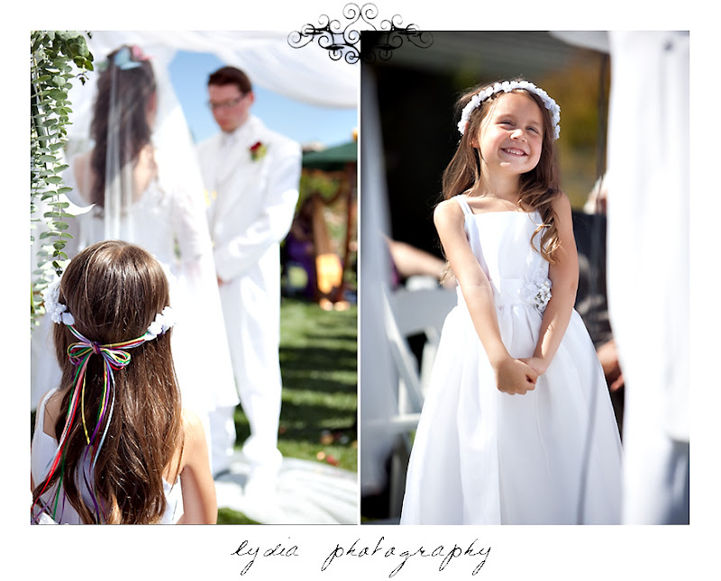 Sophia looking at Rosemary and Jared during the wedding in Santa Rosa California