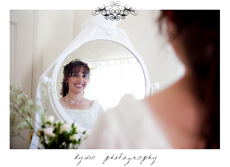 Rosemary looking in the mirror for a picture before the wedding in Santa Rosa California