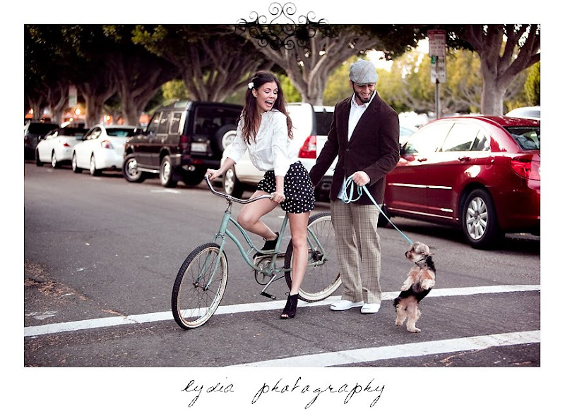 Jamie riding a vintage bike and Soheil walking for their pictures in Sausalito California