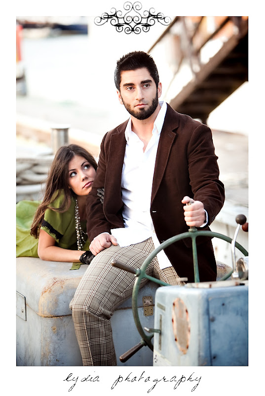 Jamie and Soheil in a boat during their portrait session in Sausalito California