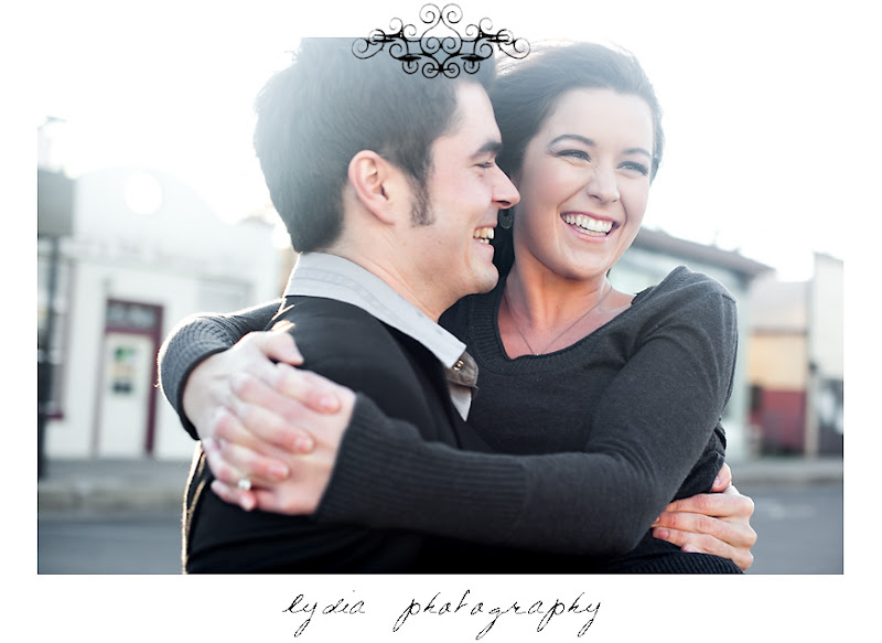 Groom carring his bride at lifestyle old town engagement portraits in Cottonwood, California