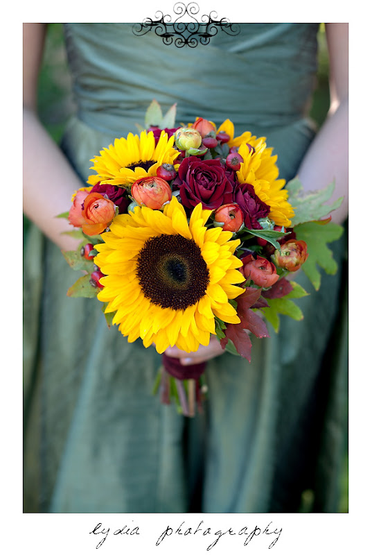 A bridesmaid's sunflower, peony, and rose bouquet at a Kenwood Farms & Gardens wedding