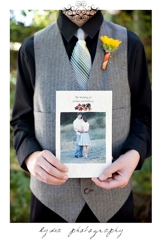 An usher holding a fall wedding program at a Kenwood Farms & Gardens wedding