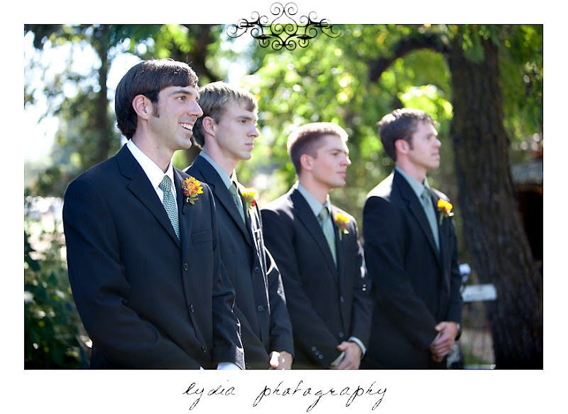 The groom and groomsmen seeing the bride for the first time come down the aisle at a Kenwood Farms & Gardens wedding