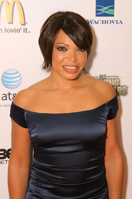 Even Though Tisha Campbell Navy Satin Dress Is Not A Wow Factor, She