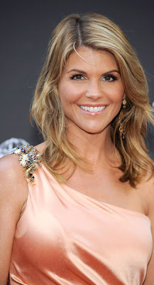 Lori Loughlin looks elegant as ever in this peach satin one-shouldered dress ...