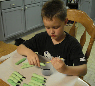 My son helping with to paint fingernails.