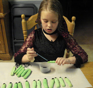 My daugher painting fingernails in her gothic costume.