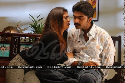 Hot Nayanthara Seducing a man in sexy mood on sofa : South Indian Masala