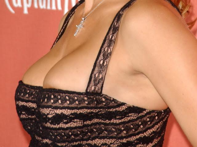 Tricia Helfer cleavage nip slip