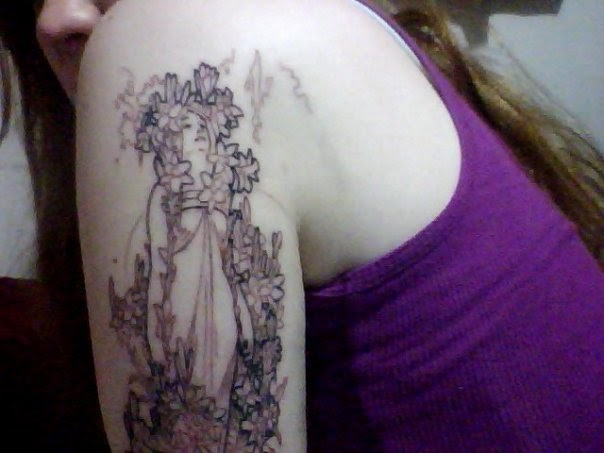 I took this with my webcam right after I got my first Mucha tattoo,