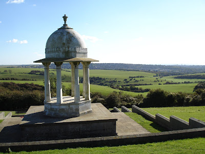 The Chattri, with Hollingbury in the distance and a glimpse of the sea.