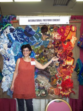 Myra Woods, head of the IFC, displays 'Earth, Air, Fire, Water' exhibit at the 2007 CGOA National Conference in Manchester, NH