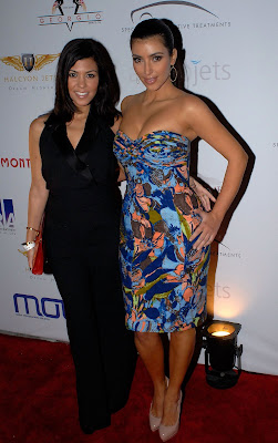 Kourtney and Kim Kardashian together 2009 Moves Magazine