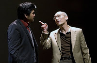 Playwright D.H.H. (Pun Bandhu, left) takes a lesson on the American dream from his father, H.Y.H. (Francis Jue, right) in the Bay Area premiere of Yellow Face at TheatreWorks.