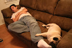 Joe and our dog sleeping.