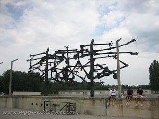 the memorial statue depicting figures of dead people