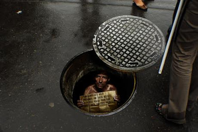 Creative and Clever Uses of Manhole In Advertisements (6) 1