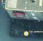 Car Parked on Side of a Building (3) 1