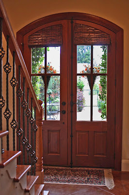 Southern Lagniappe: Decorating Solution: Arched Doors with Glass Panes